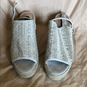 Beige woven platform sandals by Steve Madden